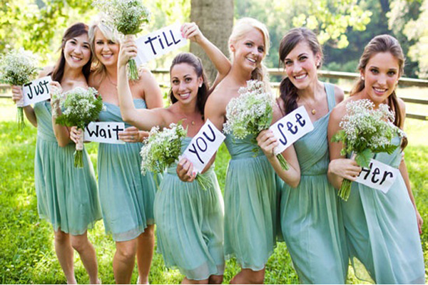 bridesmaids with wedding signs